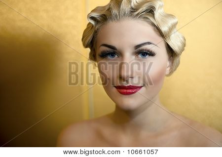 Portrait Of Beautiful Girl With Blue Eyes And Red Lips