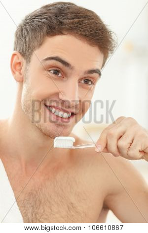 Attractive guy is preparing for the date