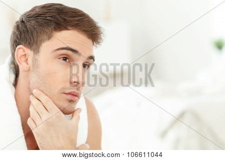Cheerful guy is preparing himself for meeting