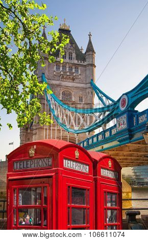 Red British telephone box in front of Tower bridge, London