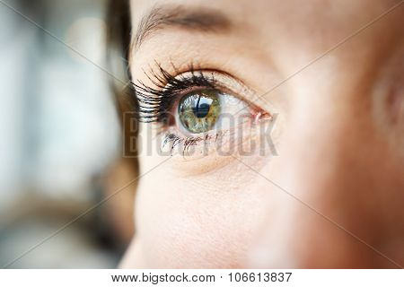 woman green eye closeup