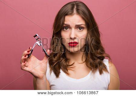 Beautiful Woman With An Eyelash Curler
