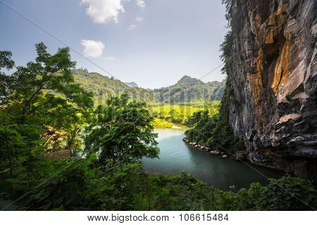 Calm river flowing from the cave in the National Park Phong Nha, Vietnam