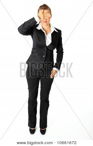 Full length portrait of modern business woman with hand on eyes