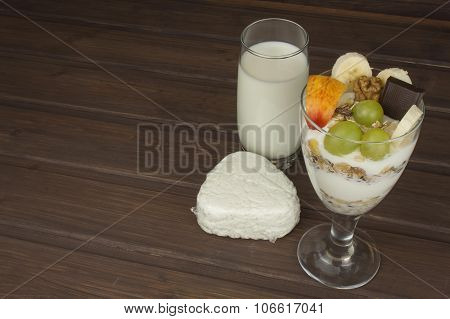 fresh milk in the glass and muesli breakfast. Oatmeal with milk and curd