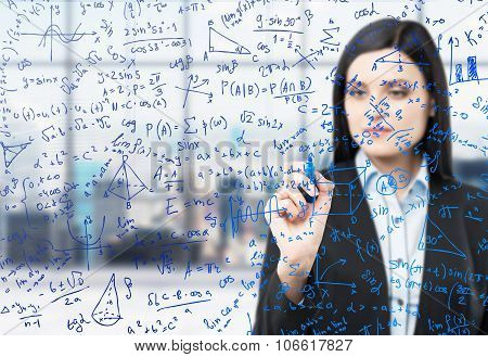 A Brunette Woman Is Writing Down Math Formulas In The Glass Screen. Modern Panoramic Office With New