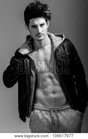 Athletic Man Wearing Hoodie Jacket. Studio Shot