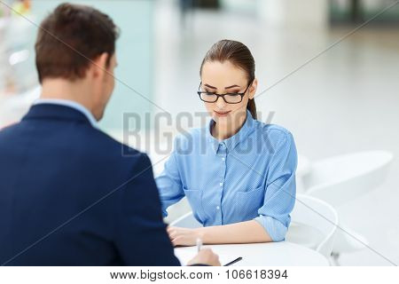 Two employees at the table working together.