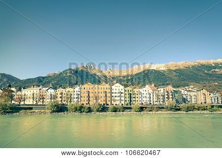 Innsbruck Postcard With Tirol Mountains On The Background - Horizontal View Of Colorful Buildings