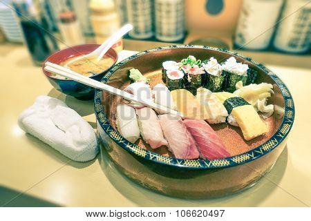 Original Plate Of Nigiri At Japanese Restaurant In Tokyo City - Vintage Filtered Look