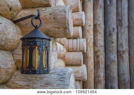 Old street light closeup on wooden wall