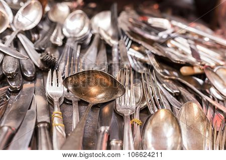 Bunch Of Old Silver Ware On A Flea Market