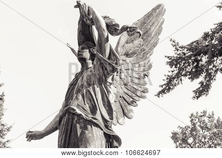 B/w Shot Of An Angel Sculpture With White Sky