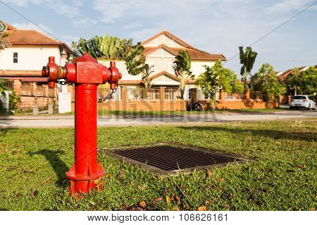 Red Fire Hydrant At Strategic Residential Ready For Emergency
