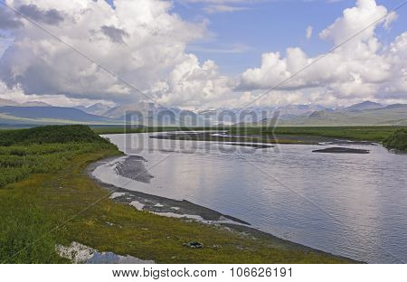 Glacier And Glacial River In The Wilds