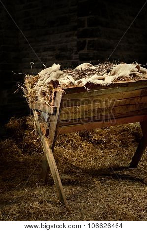 Manger with crown of thorns. Conceptual representation of the birth and death of Christ.