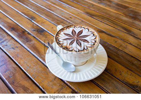 Latte Coffee Art On The Wooden Desk.