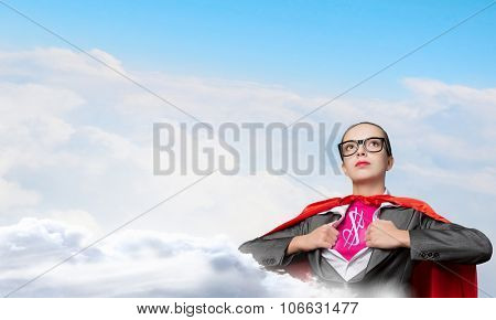 Young woman acting like super hero with dollar sign on chest