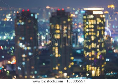 Blurred bokeh city lights city building at night