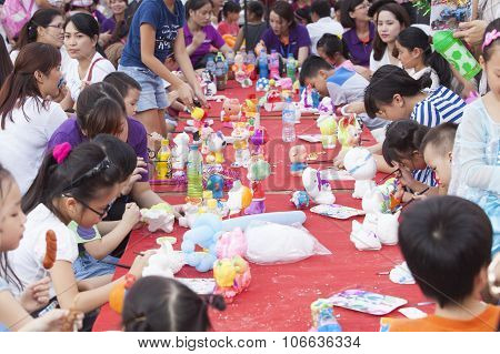 Asian children painting and writing their wishes on wishing cards