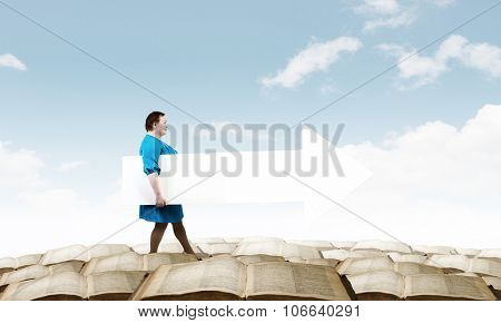 Stout woman of middle age with blank white arrow banner