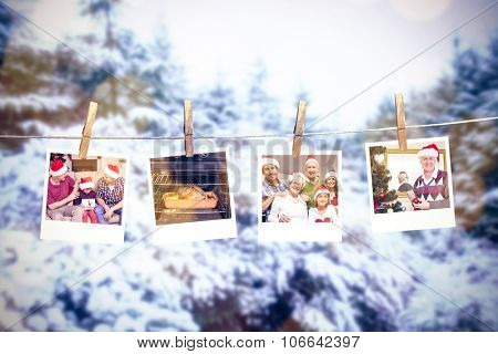 Clothes peg on line with instant photos against snow covered trees against sky