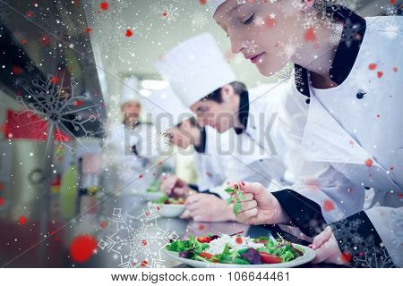 Snow against chef finishing her salad in culinary class