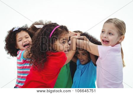 Small group of girls huddled together against a white background