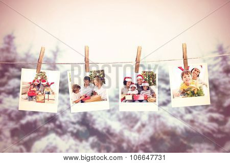 Cheerful family celebrating Christmas against black abstract light spot design