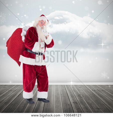 Santa keeping a secret against clouds in a room
