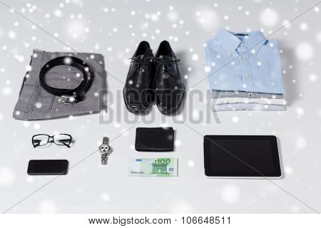 business, style, clothes and objects concept - close up of formal male clothes and personal stuff on table at home over snow effect over snow effect