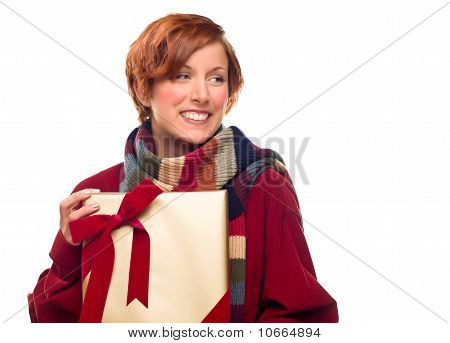 Pretty Girl With Gift Looking To The Side Isolated