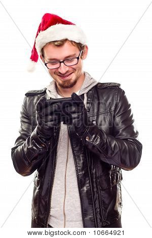 Young Man With Santa Hat Using Cell Phone