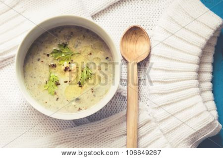Chicken cream stew on white knitted sweater