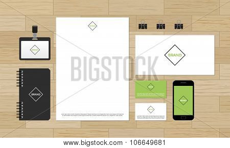 Corporate identity design mock-up on wooden background.