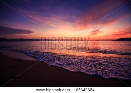 View Of Surf Against Fantastic Dark Blue Red Sky Before Sunrise