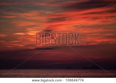 View Of Red Fleecy Clouds Before Sunrise Sea On Foreground