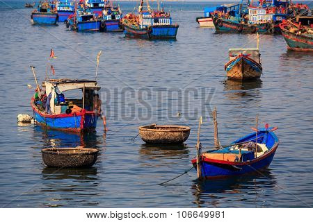 Closeup Colourful Fishing Boats In Azure Sea Against Island
