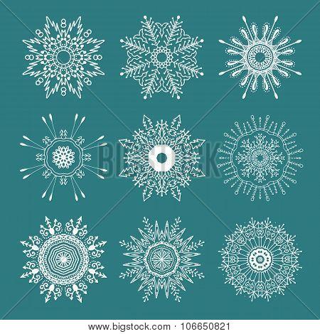 Set of 9 hand drawn symmetric white snowflakes