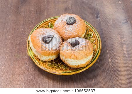 Three Donuts On A Plate
