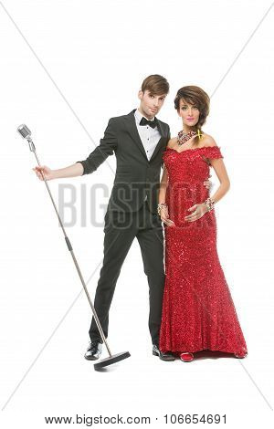 Woman and man performing song in retro microphone