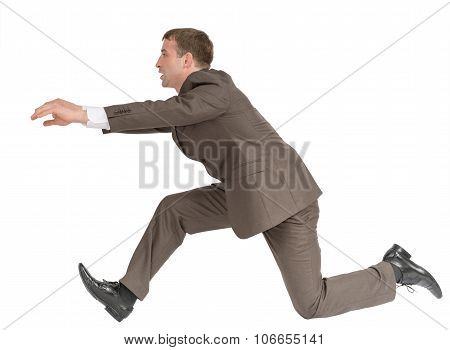 Businessman running fast with empty hands on white