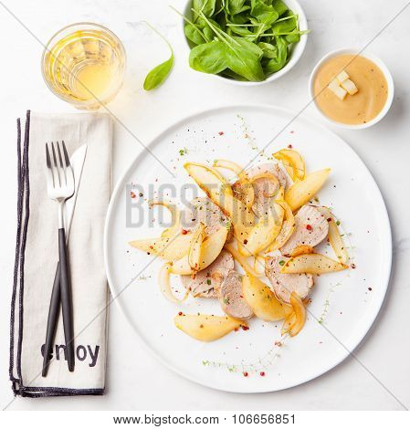 Pork tenderloin roasted with pear, onion, glass of white wine .