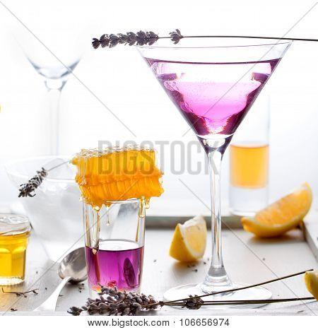 Martini, lavender, honey, lemon cocktail on a white background. Vermouth.