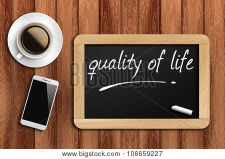 Coffee, Phone And Chalkboard With Words Quality Of Life