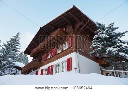 Exterior of the traditional wooden chalet Meierisu in Murren, Switzerland.