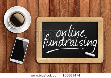 Coffee, Phone And Chalkboard With Word Online Fundraising