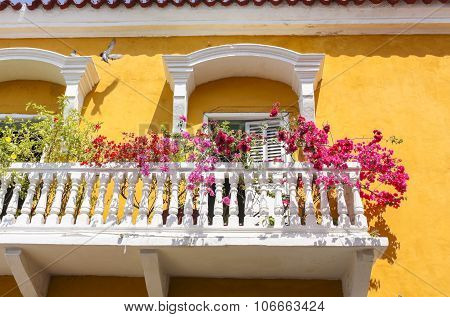 Facade Of The Colonial House With Balconies