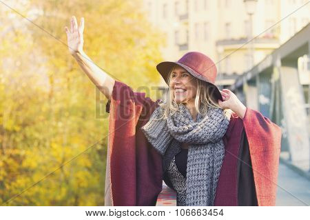 Woman Standing On Bridge And Waving To Someone