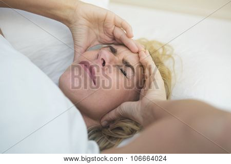 Woman In Bed In Pain